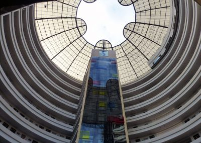Cali Colombia: Looking up at from the lobby. Glass elevator shaft.