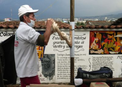 """Cali Colombia: This guy is """"pulling"""" marshmallow on a stick."""