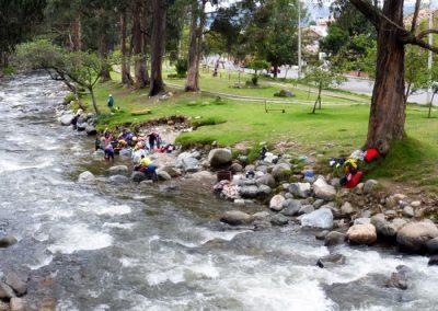Locals doing their laundry in the Rio Tomebamba; Cuenca Ecuador