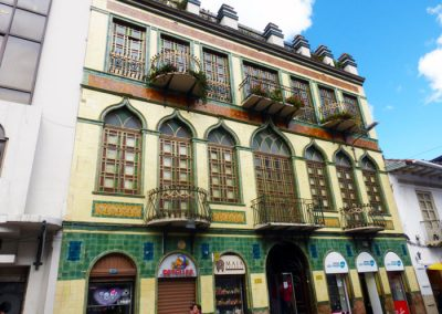 Pretty yellow and green building; Cuenca Ecuador